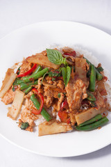 Thai spicy food, stir fried chicken whit basil and rice.