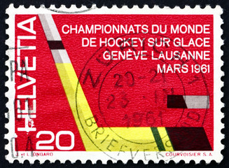 Postage stamp Switzerland 1961 Ice Hockey Stick and Puck