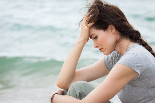 Sad and upset woman deep in thought