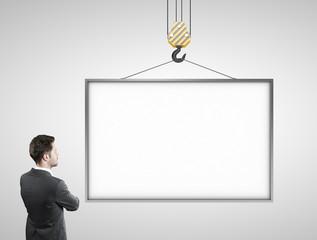 man looking at blank billboard