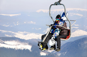 Skiers couple on a ski lift
