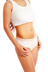 Closeup of a slim female body, isolated on white, side-view