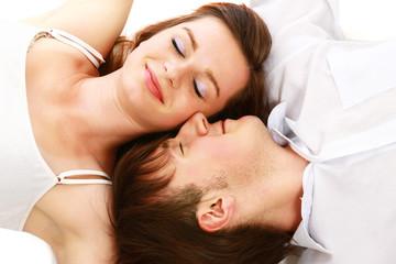 Closeup of happy young couple lying on floor