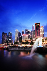 Singapore evening skyline with Merlion statue