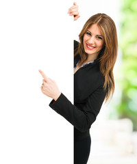 Business woman pointing her finger to a white board
