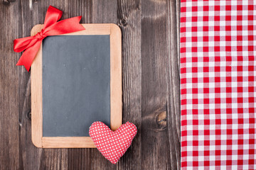 Love Valentine heart and blackboard, tablecloth on wood