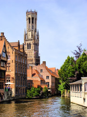 Foto op Canvas Brugge The famous Belfry and canal scene in Bruges, Belgium