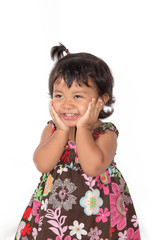 Happy smiling little girl standing and holding cheek