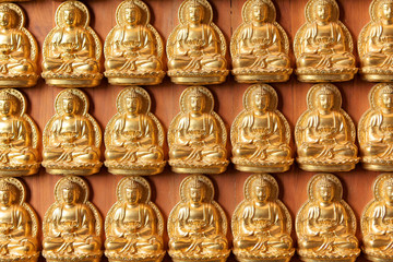 Golden Buddha images on wall