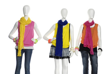 Three fashion dress with scarf on mannequin isolated