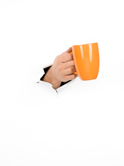 male hand holding orange cup