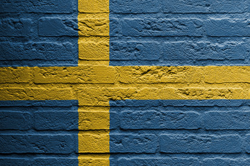 Brick wall with a painting of a flag, Sweden