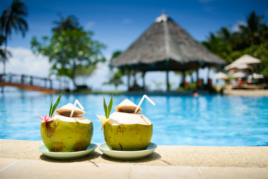 Pina colada drink in front of pool