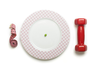 Plate with one peas. Dumbbell and centimeter measure.