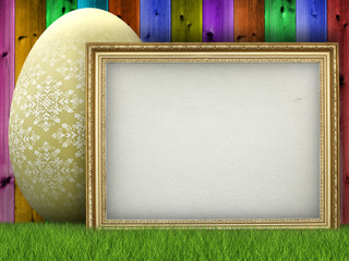 Easter background - easter egg and blank sheet in picture frame