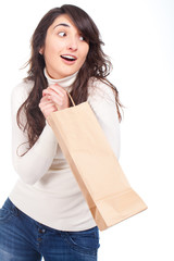 Young beautiful woman smiling with a paper bag