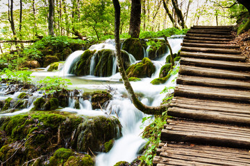 Wooden track near a forest waterfall in Plitvice Lakes National