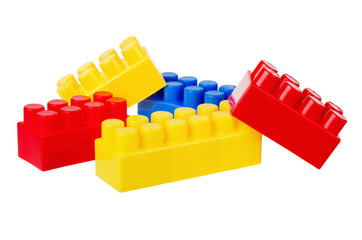 Multi-coloured Plastic building blocks, it is isolated on white