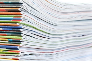 A large stack of colorful magazines. Close-up.