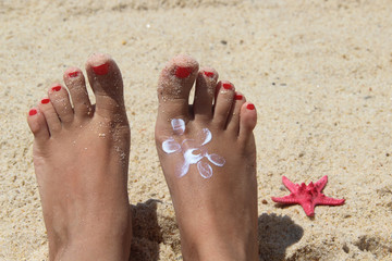 Female feet on the beach