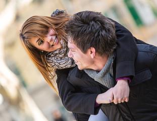 Happy Man Holding his Girlfriend Piggyback