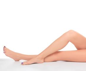 Female legs with blue toenails