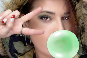 Beauty Hiphop Woman in Camouflage Hoodie. Green Bubble Gum