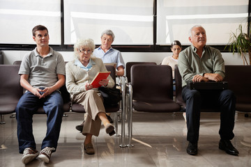 People Sitting In Hospital Lobby