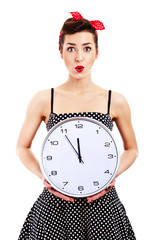 Pin-up girl on white background holding clock