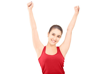 Young happy female with raised hands gesturing happiness