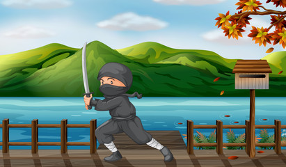 A gray ninja with a sharp sword near the wooden mailbox