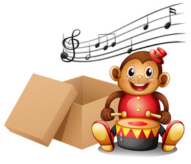 A monkey playing with musical notes and an empty box