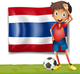 A football player in front of a thai flag