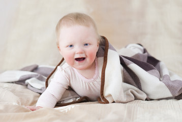 Cute baby with a blanket