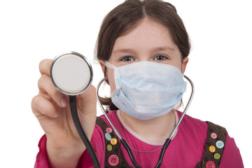 Little girl with stethoscope and surgical mask