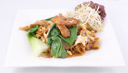 Asian stir fried flat rice noodles. Pad se ew with chicken.