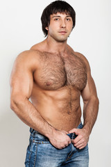 Muscular young man with naked torso