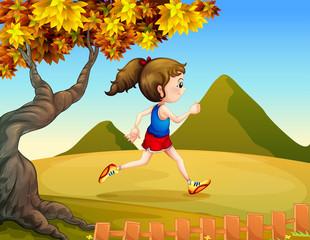 A woman jogging at the hills