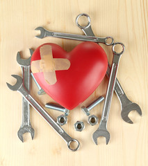 Heart and tools. Concept: Renovation of heart. On wooden