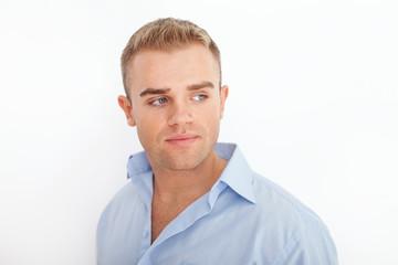 Closeup portrait of happy smiling young businessman