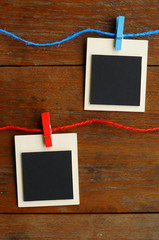Blank photo frames on red and blue line