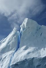 Tip of an iceberg against a blue sky Antarctic summer.