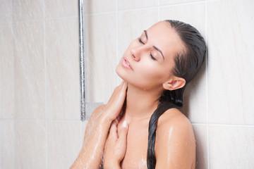 Young beautiful woman washing in the shower