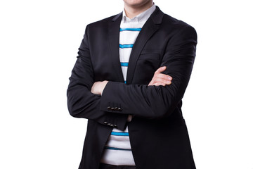 A businessman stands with his arms crossed