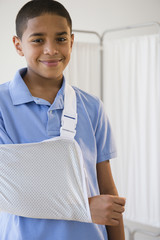 Hispanic boy with arm in sling