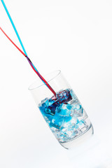 Blue and red stream mixing in a drink