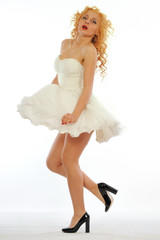 Pin-Up Girl with short white dress on white background