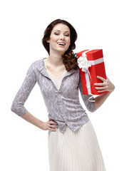 Young woman is glad to receive a gift wrapped in red paper