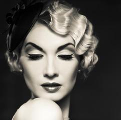 Monochrome picture of elegant blond retro woman