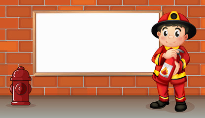 A fireman with a fire extinguisher in front of an empty board